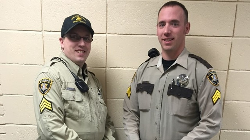 Feb. 2, 2015: In this photo provided by the Sublette County Sheriff's Office, Detention Sergeant Travis Bingham, left and Patrol Sergeant Rich Kaumo pose in two of the different uniforms previously utilized by the Sublette County Sheriff at the Sheriff's Office on Monday, Feb. 2, 2015, in Pinedale, Wyo. (AP Photo/Sublette County Sheriff's Office, Sgt. Katherine A. Peterson)