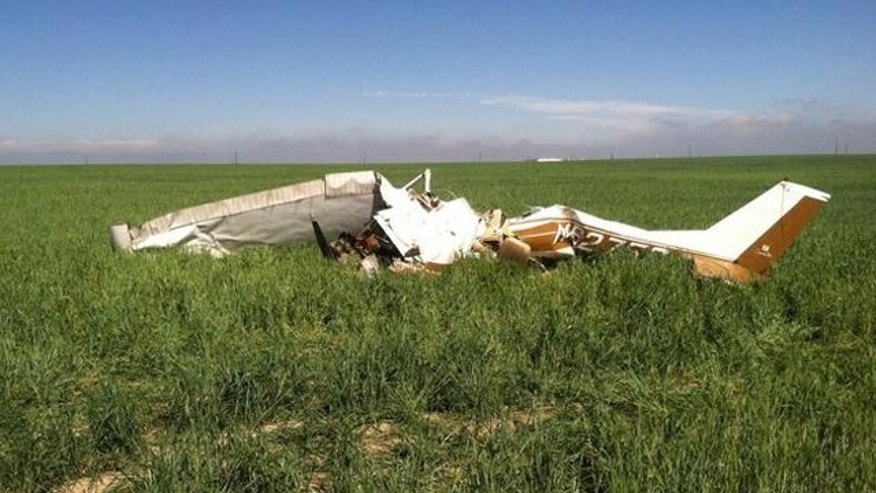 May 31, 2014: This photo shows the wreckage of a small plane that killed 2 people when it crashed in Adams County, Colo. (Adams County Sheriff's Department)