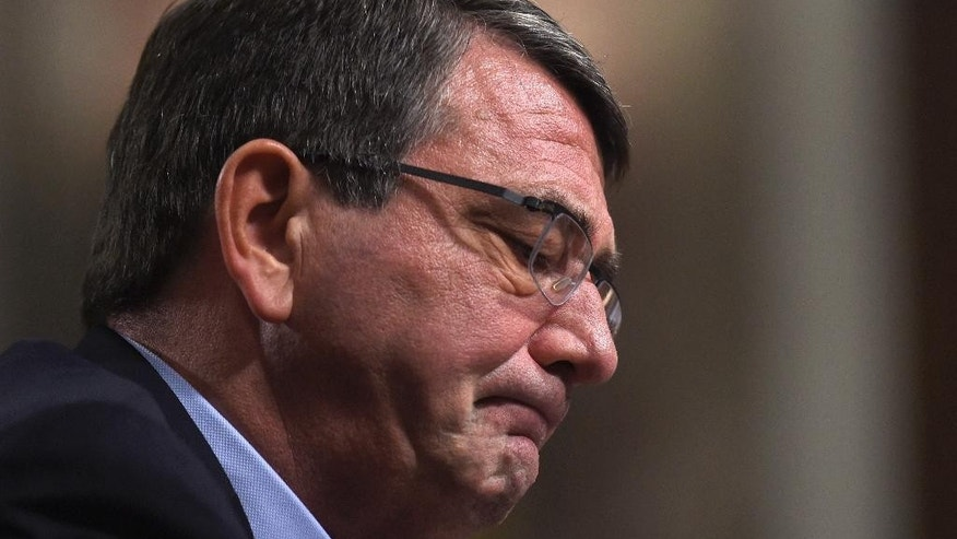Ashton Carter,  President Barack Obama's choice to head the Defense Department, pauses as he testifies on Capitol Hill in Washington, Wednesday, Feb. 4, 2015,  before the Senate Armed Services Committee hearing on his nomination to replace Chuck Hagel. Carter, who previously served as the No. 2 Pentagon official, is expected to easily win Senate confirmation but will face tough questions about Iraq and other issues. (AP Photo/Susan Walsh)