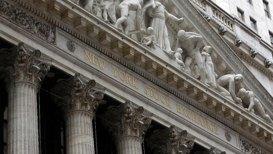 FILE - This Thursday, Oct. 2, 2014, file photo, shows the facade of the New York Stock Exchange. Stock markets turned lower on Wednesday, Feb. 4, 2015, despite upbeat economic data in Europe, while the price of oil's four-day rebound ran out of steam. (AP Photo/Richard Drew, File)