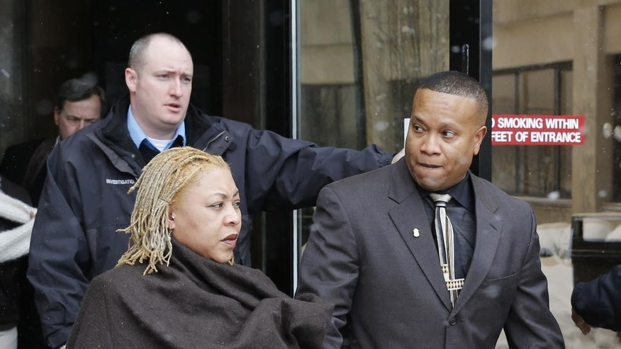 "Park Forest Police Officer Craig Taylor, right, leaves the Markham, Ill., courthouse with his wife, Freddie, after being found not guilty in the 2013 beanbag shooting death of 95-year old World War II veteran, Wednesday, Feb. 4, 2015. In a courtroom packed with officers supporting Taylor, Cook County Judge Luciano Panici said there was nothing criminal about Taylor's actions and that the officer did ""what he was trained to do.""(AP Photo/Charles Rex Arbogast)"