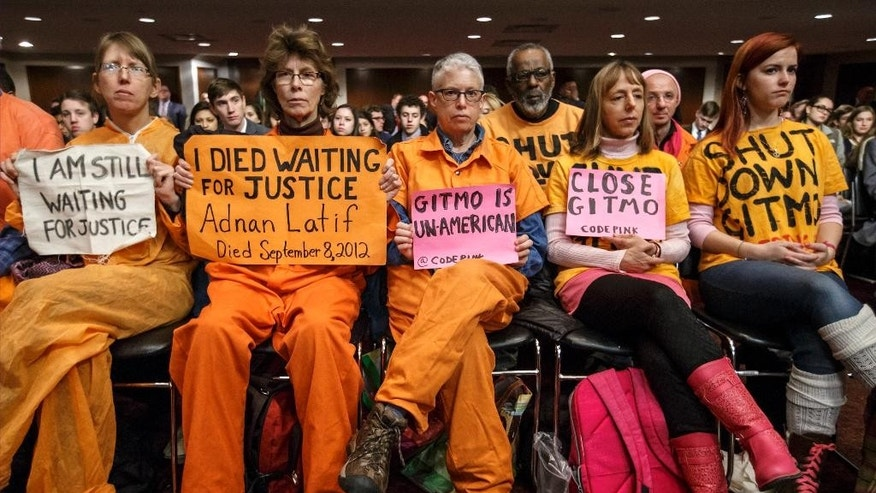 Activists from the antiwar group CodePink, including co-founder Medea Benjamin, second from right, hold silent protest at the Senate Armed Services Committee during a hearing on the detention center in Guantanamo, Cuba, Thursday, Feb. 5, 2015, on Capitol Hill in Washington. A week ago, the same group drew the ire of Armed Services Chairman Sen. John McCain, R-Ariz., when they interrupted a hearing with former Secretary of State Henry Kissinger and charged the witness table. (AP Photo/J. Scott Applewhite)