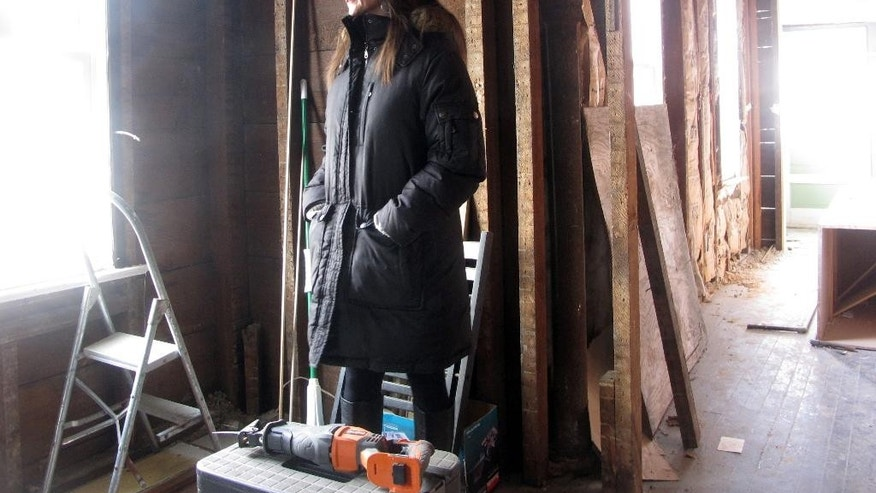 This Feb. 4, 2015 photo shows Krista Sperber inside her storm-damaged home in Belmar, N.J. The Jersey shore town began an effort on Feb. 5, 2015 to raise the $200,000 it will take to get Sperber's family and one other family back into their homes by June 1. Belmar's mayor says the families are the last in town that are still not able to return to their homes following the Oct. 2012 storm. (AP Photo/Wayne Parry)