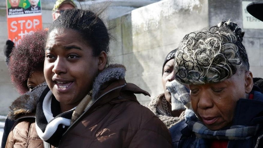 Erica Garner, left, daughter of chokehold death victim Eric Garner, and his mother Gwen Carr, talk to the press after attending a court hearing, in the Staten Island borough of New York, Thursday, Feb. 5, 2015. Civil liberties lawyers urged a state judge on Thursday to reveal secret grand jury testimony concerning the police chokehold death of Eric Garner, an unarmed man, saying the public needs to reconcile a video of the arrest with the decision not to indict the officer involved. (AP Photo/Richard Drew)