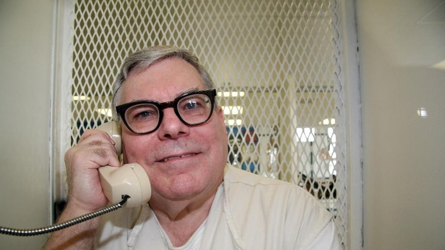 In this photo taken Jan. 7, 2015, Texas death row inmate Lester Bower, 67, speaks on a phone in an interview cage at the visiting area of the Texas Department of Criminal Justice Polunsky Unit near Livingston, Texas. Bower, set to be executed next week for fatally shooting four men at an airplane hangar more than 30 years ago, won a reprieve Thursday, Feb. 5, 2015, from the U.S. Supreme Court. The justices gave no reason for the reprieve, saying only that it would be lifted automatically if they deny an appeal or act on it. (AP Photo/Michael Graczyk)