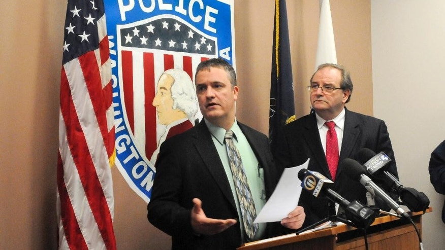 City of Washington Det. Dan Stanek, left, and Washington County District Attorney Eugene Vittone discuss during a news conference the details of the fatal shooting of Jerred Price, 42, by Jerald Thompson, 18, the boyfriend of his daughter, Friday morning, Feb. 6, 2015, in Washington, Pa. Authorities say the father was coming to his daughter's aid after she had a fight with her boyfriend and was shot dead from the upstairs window of their Pennsylvania home. (AP Photo/Observer-Reporter, Jim McNutt)
