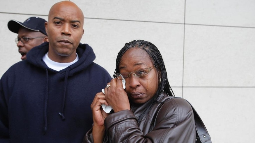 "FILE - In this July 8, 2010, file photo, Family members of victim Alicia Monique Alexander: Sherry Alexander, right, and husband Darin Alexander, left, react during a news conference to announce the arrest of a suspect in the ""Grim Sleeper"" serial killings downtown Los Angeles. Relatives of victims will urge a Los Angeles Superior Court judge Friday, Feb. 6, 2015, to set a trial date for  Franklin, who is charged with 10 counts of murder, and has been dubbed the ""Grim Sleeper"" serial killer. Prosecutors are citing Marsy's Law, a voter-approved victim's bill of right, to argue that the right to a speedy trial, guaranteed for defendants, also extends to family members of the victims. (AP Photo/Damian Dovarganes, File)"
