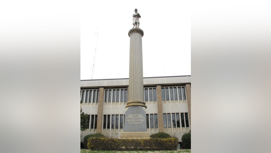 In this Jan. 22, 2015 photo, shows the Greenwood County memorial to confederate soldiers in Greenwood, S.C. The memorial, like others around the state, is protected by part of a South Carolina law passed with the Confederate flag compromise of 2000. It  requires a 2/3 vote to alter any publicly owned monument in the state. (AP Photo/Jeffrey Collins)