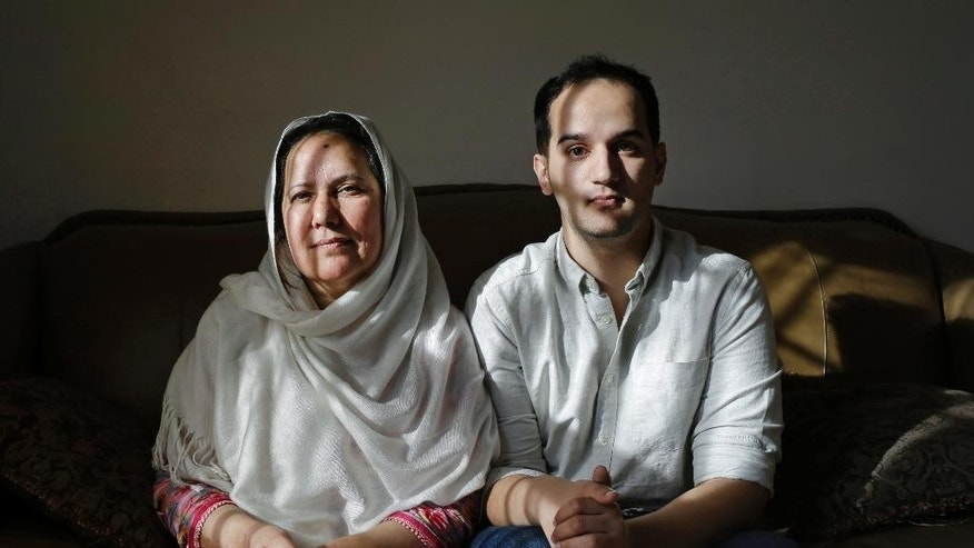 "FILE - In this Dec. 10, 2014 file photo, Shamim Syed, left, whose son Adnan was convicted for the 1999 murder of his ex-girlfriend  poses for a photograph alongside her son Yusef in her home  in Baltimore. Adam Syed, the subject of the popular podcast ""Serial"" will be allowed to appeal his murder conviction, a Maryland court has ruled.  Syed, 34, was convicted in 2000 of strangling his ex-girlfriend, Hae Min Lee, the year prior, when both were high school students in suburban Baltimore. ""Serial"" examined the case in detail and raised questions about Syed's guilt and whether he received a fair trial. (AP Photo/Patrick Semansky)"