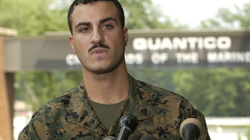 July 19, 2004: U.S. Marine Corps Corporal Wassef Ali Hassoun reads a prepared statement outside the gate at Quantico Marine Corps Base in Northern Virginia, 35 miles south of Washington. (Reuters)