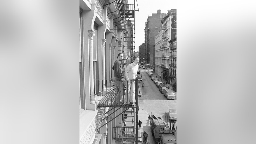 March 17, 1980: In this file photo, Stan and Julie Patz stand on the second-floor fire escape of the of their loft in the SoHo neighborhood of New York. (AP)