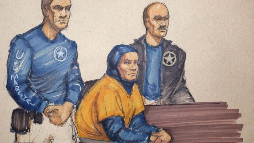 In this Monday, Feb. 9, 2015 courtroom sketch, Mediha Medy Salkicevic, center, appears in federal court in Chicago. Salkiceveic is accused with five other Bosnian immigrants of sending money and equipment to extremist groups in Syria. Salkiceveic appeared before Judge Jeffrey Cole who put off a decision until Tuesday about whether to allow Salkicevic out of jail to travel to St. Louis, where the case originated, rather than remain in custody and be transported by U.S. Marshals. (AP Photo/Tom Gianni)