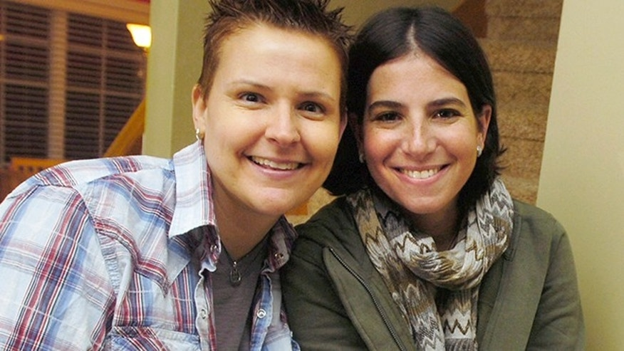 Feb. 5, 2015: In this 2011 file photo, Niki Quasney, left, poses for a photo with Amy Sandler, in Munster, Ind. Lambda Legal announced Sunday that Quasney of Munster died Thursday, Feb. 5, 2015. She was 38.
