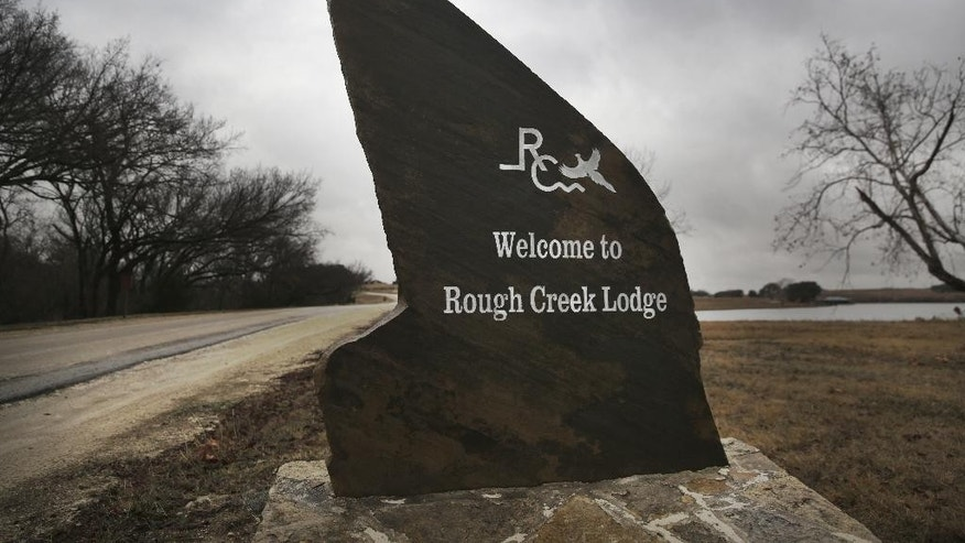 "In this Thursday, Jan. 22, 2015 photo, a sign welcomes visitors to the Rough Creek Lodge resort near Glen Rose, Texas.  Eddie Ray Routh, the Iraq war veteran who was battling post-traumatic stress disorder and other personal demons is scheduled to stand trial in nearby Stephenville, Texas, this week in the slayings of two men who were trying to help him, one of them former Navy SEAL Chris Kyle, subject of the Hollywood blockbuster ""American Sniper."" (AP Photo/LM Otero)"
