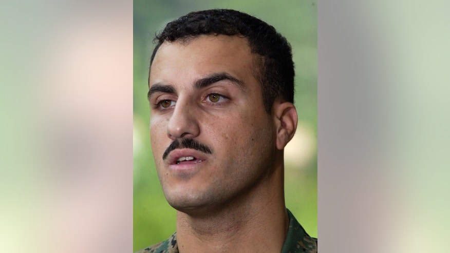 FILE - In this July 19, 2004 file photo, Marine Cpl. Wassef Ali Hassoun makes a statement to the press outside Quantico Marine Base in Quantico, Va. Hassoun's trial on desertion accusations starts Monday, Feb. 9, 2015 at Camp Lejeune, N.C. (AP Photo/Steve Helber, File)
