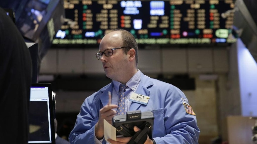 Trader Peter Mancuso on the floor at the New York Stock Exchange in New York, Monday, Feb. 9, 2015. U.S. stocks are opening lower, following declines in overseas markets on weak Chinese trade data and more worries about Greece's finances. (AP Photo/Seth Wenig)