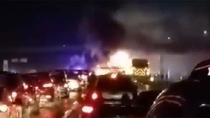 Feb. 9, 2015: This photo shows a car on fire following a multi-car pileup in the southbound lanes of the New Jersey Turnpike near Cranbury, N.J. (Courtesy Ahsan Naqvi)