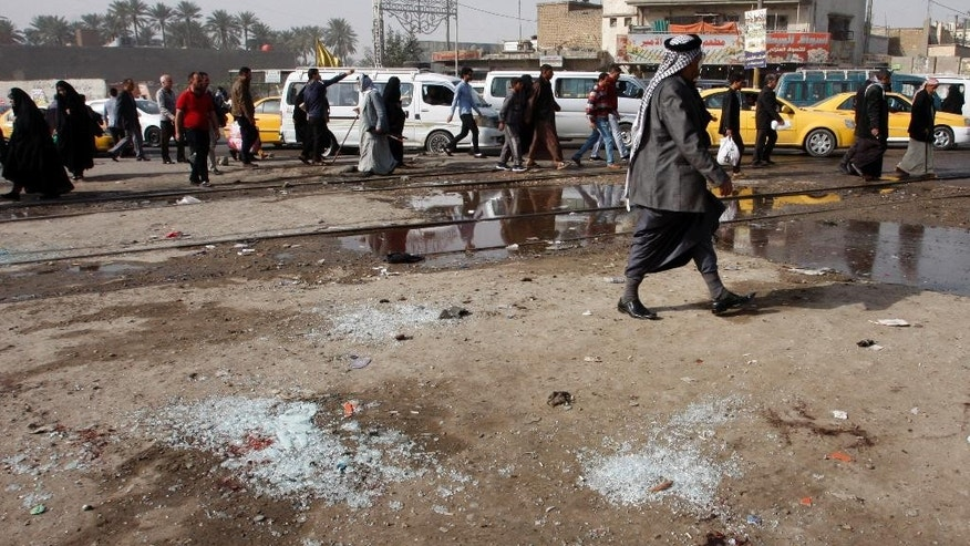 Broken glass remains at the scene of a suicide bomb attack at Adan Square, located in a predominantly Shiite part of the capital, Baghdad, Iraq, Monday, Feb. 9, 2015.  President Barack Obama is expected, as early as Tuesday, to ask Congress for new war powers, sending Capitol Hill his blueprint for an updated authorization for the use of military force to fight the Islamic State group. Haggling then begins on writing a new authorization to battle the Sunni extremists, who have seized territory in Iraq and neighboring Syria and imposed a violent form of Sharia law. (AP Photo)