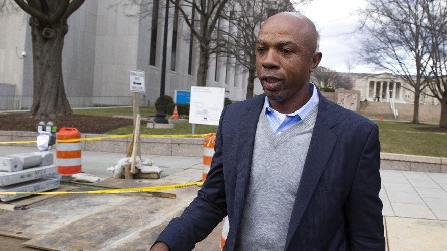 FILE - In this Feb. 2, 2015 file photo, basketball analyst Greg Anthony leaves the D.C. Superior Court in Washington. Anthony will have a soliciting prostitution charge dropped if he does 32 hours of community service and stays out of trouble for four months.  Anthony, his attorney and a prosecutor told a judge Wednesday that they had agreed to the deal, called a deferred prosecution agreement.  (AP Photo/Cliff Owen, File)