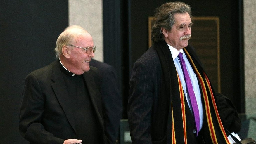 The Rev. Eugene Klein, left, and his attorney, Thomas Anthony Durkin, walk into Dirksen U.S. Courthouse on Wednesday, Feb. 11, 2015, in Chicago. Klein pleaded guilty to charges of trying to help convicted mobster Frank Calabrese Sr. recover a rare, 250-year-old Stradivarius violin hidden years earlier in Calabrese's then-Wisconsin summer home. Federal prosecutors allege the plot was hatched in 2011 when Klein administered daily communion to Calabrese at the Missouri prison where he was serving a life sentence for 13 murders. Calabrese died in December 2012.  (AP Photo/Chicago Tribune, Anthony Souffle )   MANDATORY CREDIT; CHICAGO SUN-TIMES OUT; DAILY HERALD OUT; NORTHWEST HERALD OUT; JOLIET HERALD OUT; THE TIMES OF NORTHWEST INDIANA OUT; NEW YORK TIMES OUT; TV OUT; MAGS OUT; NO SALES; DAILY CHRONICLE OUT