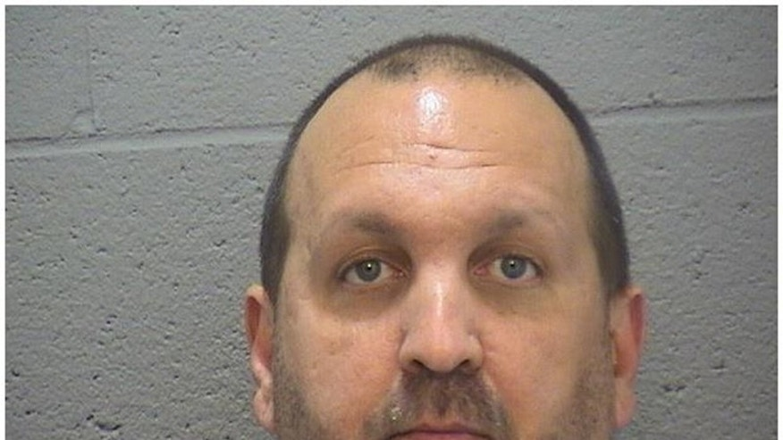 This image provided by the Durham County Sheriff's office shows a booking photo of  Craig Stephen Hicks, 46, who was arrested on three counts of murder early Wednesday Feb. 11, 2015. He is being held at the Durham County Jail. Police were responding to a report of gunshots around 5:15 p.m. Tuesday when they found three people who were pronounced dead at the scene. The dead were identified as Deah Shaddy Barakat, 23, of Chapel Hill; Yusor Mohammad, 21, of Chapel Hill; and Razan Mohammad Abu-Salha, 19, of Raleigh. (AP Photo/Durham County Sheriff)