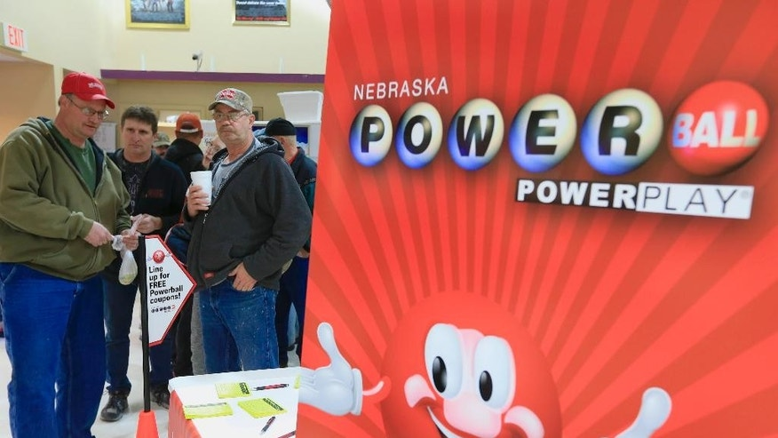 People wait in line at Russ's Market in Lincoln, Neb., where Powerball tickets were to be handed out for free as part of a promotion, Wednesday, Feb. 11, 2015. The Powerball jackpot has climbed to an estimated $500 million, which would make it the fifth largest lottery prize in U.S. history. (AP Photo/Nati Harnik)
