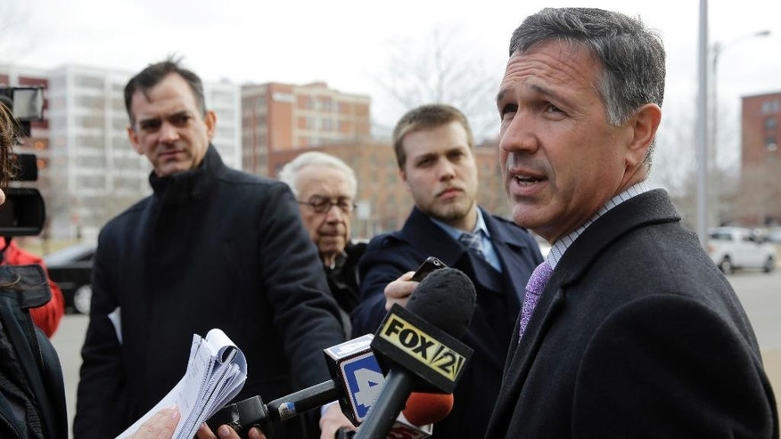 Paul J. D'Agrosa, attorney for Sedina Hodzic, speaks outside federal court following a hearing Wednesday, Feb. 11, 2015, in St. Louis. Sedina Hodzic and her husband Ramiz Hodzic have pleaded not guilty to federal charges of funneling money and military supplies to extremist groups in Iraq and Syria. (AP Photo/Jeff Roberson)