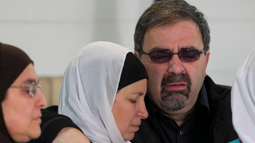 Namee Barakat, right, embraces his wife Layla Barakat during a news conference on Wednesday, Feb. 11, 2015, in Raleigh, N.C. They are the parents of Deah Shaddy Barakat, a doctoral student at UNC-Chapel Hill's School of Dentistry who was killed Tuesday in Chapel Hill, N.C., along with his wife Yusor Mohammad and her sister Razan Mohammad Abu-Salha. (AP Photo/The News & Observer, Robert Willett) MANDATORY CREDIT