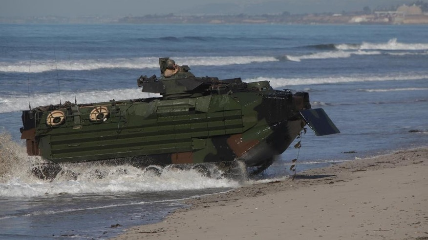 This image provided by the U.S. Marine Corps shows Marines from the 13th Marine Expeditionary Unit landing their amphibious assault vehicle Feb. 13, 2013 at Camp Pendleton, Calif. during Exercise Iron Fist. Nearly two dozen Marines were treated for exposure to a fire retardant gas Thursday Feb. 13, 2015 after an extinguishing system accidentally went off in an assault vehicle similar to the one shown during a training exercise, but there were no serious injuries, officials said. (AP Photo/U.S. Marine Corps,  Sgt. Christopher O'Quin)