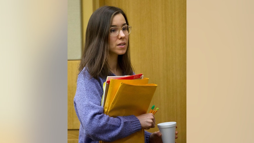 Jodi Arias leaves the courtroom during her resentencing trial at Maricopa County Superior Court ,Thursday, Feb 12, 2015, in Phoenix. Arias was convicted of first-degree murder in May 2013 in the 2008 killing of former boyfriend Travis Alexander. However, jurors deadlocked on her punishment. (AP Photo/The Arizona Republic, Cheryl Evans, Pool)