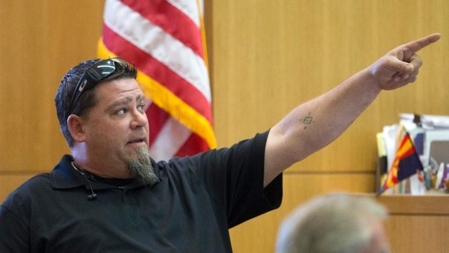 Damien Ashdown testifies about an email he had sent to Travis Alexander during Jodi Arias' sentencing retrial at Maricopa County Superior Court, Thursday, Feb 12, 2015, in Phoenix. Arias was convicted of first-degree murder in May 2013 in the 2008 killing of former boyfriend Travis Alexander. However, jurors deadlocked on her punishment. (AP Photo/The Arizona Republic, Cheryl Evans, Pool)