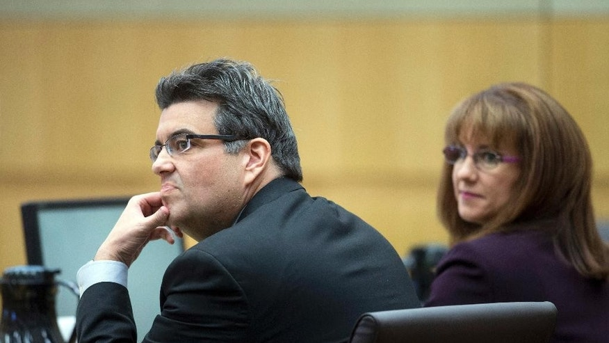 Defense attorneys Kirk Nurmi, left, and Jennifer Willmott listen during Jodi Arias' sentencing retrial at Maricopa County Superior Court, Thursday, Feb 12, 2015, in Phoenix. Arias was convicted of first-degree murder in May 2013 in the 2008 killing of former boyfriend Travis Alexander. However, jurors deadlocked on her punishment. (AP Photo/The Arizona Republic, Cheryl Evans, Pool)