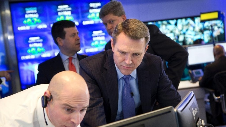 Jay Heller, left, IPO Execution Officer for Nasdaq, shows Keith Dunleavy, CEO of Inovalon, the progress of pricing for his company's stock on computer screens during the Bowie, Maryland health-tech firm's IPO at the Nasdaq MarketSite, Thursday, Feb. 12, 2015 in New York.  Stocks rose in early trading Thursday as energy and technology stocks climbed. (AP Photo/Mark Lennihan)