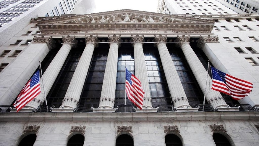 FILE - In this Feb. 10, 2011 file photo, American flags fly in front of the New York Stock Exchange, in New York. Stocks rose in early trading Thursday, Feb. 12, 2015, as energy and technology stocks climbed. (AP Photo/Mark Lennihan, File)