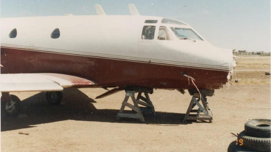 In this circa 1995 photo provided by the U.S. Attorney's Office in New York, Friday, Feb. 13, 2015, Osama bin Laden's disabled jet sits on the ground in Khartoum, Sudan. During the terrorism trial of Khaled al-Fawwaz, Ihab Mohammed Ali testified that bin Laden told him he could use his private jet to fly into then-Egyptian President Hosni Mubarak's plane, for the purpose of killing Mubarak and making himself a martyr. (AP Photo/Ihab Ali via the U.S. Attorney's Office)
