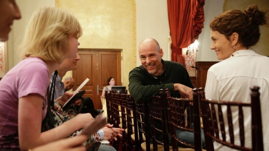 Humanist chaplain Bart Campolo, center, a former Evangelical Christian youth minister, and his wife, Marty, right, mingle with students as they wait for the start of a forum at the University of Southern California, Wednesday, Jan. 28, 2015, in Los Angeles. Humanist chaplains are ministering to students at schools like Harvard, Yale, the University of Southern California and Stanford as part of what the American Humanist Association calls a rapidly growing ethics-based spiritual movement that is taking place on America's college campuses. (AP Photo/Jae C. Hong)
