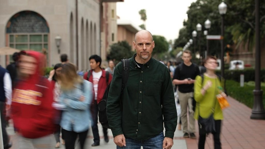 Humanist chaplain Bart Campolo, a former Evangelical Christian youth minister, pauses for photos at the University of Southern California, Wednesday, Jan. 28, 2015, in Los Angeles. Humanist chaplains are ministering to students at schools like Harvard, Yale, the University of Southern California and Stanford as part of what the American Humanist Association calls a rapidly growing ethics-based spiritual movement that is taking place on America's college campuses. (AP Photo/Jae C. Hong)