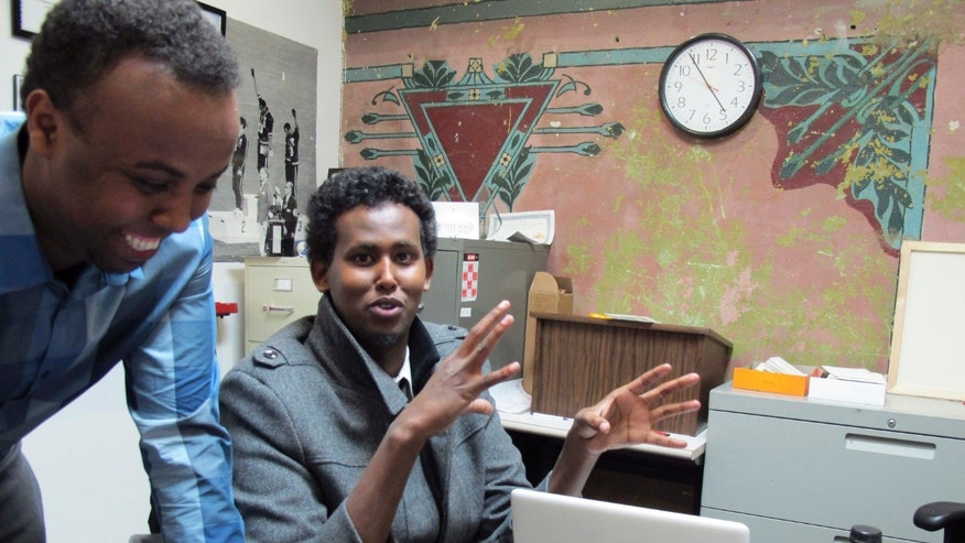 Feb. 27, 2014:  Mohamed Farah, left, executive director of Ka Joog, talks with Vice President Daud Mohamed in Minneapolis. U.S. Attorney Andy Luger will lead a delegation of local law enforcement and Somali community leaders, including Farah, to a meeting in Washington.