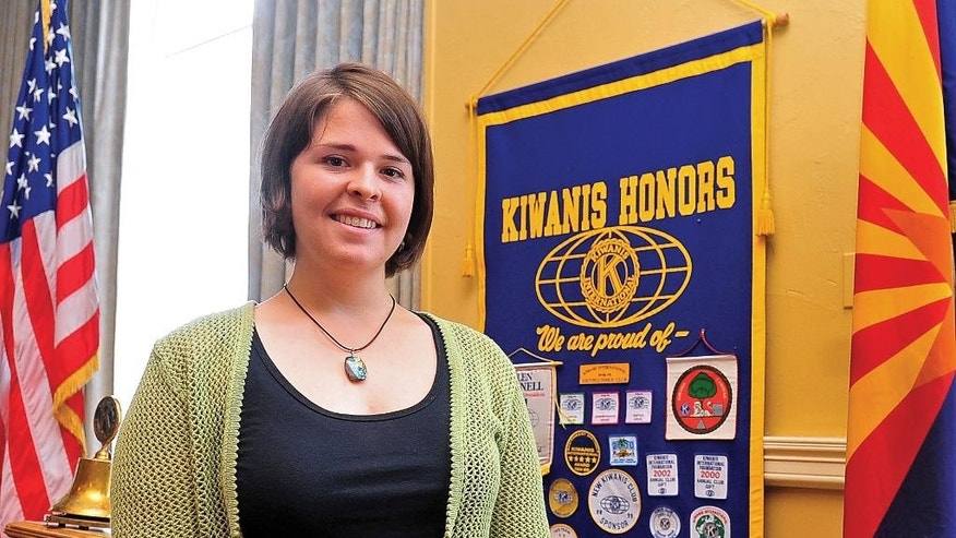 FILE -- In this May 30, 2013 file photo, Kayla Mueller is shown after speaking to a group in Prescott, Ariz. Omar Alkhani, boyfriend of Mueller, spoke to The Associated Press on Sunday, Feb. 15, 2015, via webcam from Turkey in one of his first interviews. Alkhani talked about how he met Mueller in 2010 and the last time he saw her in 2013 as a prisoner of the Islamic State group. The U.S. government and Mueller's family confirmed her death last week.  (AP Photo/The Daily Courier, Matt Hinshaw, File) MANDATORY CREDIT
