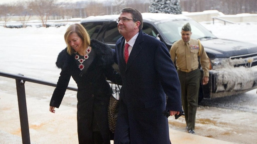 Incoming Defense Secretary Ash Carter, and his wife Stephanie Carter, during their arrival at the Pentagon in Washington, Tuesday, Feb. 17, 2015. Carter, who previously served as the No. 2 Pentagon official, replaced Chuck Hagel as the new Pentagon chief. (AP Photo/Pablo Martinez Monsivais)