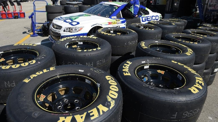 In this Feb. 14, 2015 photo, Goodyear tires surround the Casey Mears car in the garage area during a practice session for the Daytona 500 NASCAR Sprint Cup Series auto race at Daytona International Speedway, in Daytona Beach, Fla. The Goodyear Tire & Rubber Co. reports quarterly financial results on Tuesday, Feb. 17, 2015. (AP Photo/Phelan M. Ebenhack)