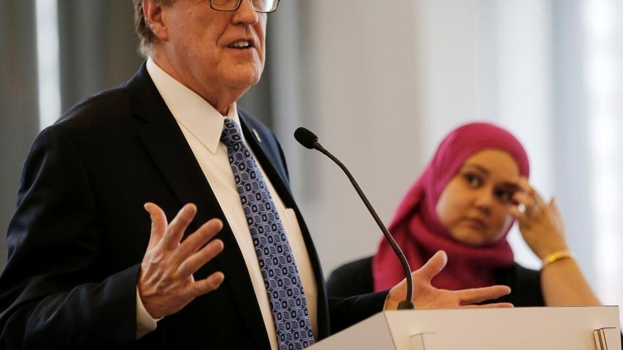 Attorney Steven Denny speaks at a news conference as Jenan Mohajir, a founding board member of HEART Women and Girls, listens at right Tuesday, Feb. 17, 2015, in Chicago. Denny filed a civil lawsuit Tuesday in Cook County Circuit Court against Mohammad Abdullah Saleem, 75, and the Institute of Islamic Education, accusing the longtime imam of sexually abusing three former female students and an employee at the school in Elgin, Ill. Saleem, of Gilberts, Ill., was arrested Sunday, Feb. 15 and charged with sexually abusing a 23-year-old woman who worked at the school. Denny says she is the employee in the suit. (AP Photo/Kiichiro Sato)