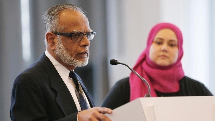 Dr. Mohammed Kaiseruddin, chairman of the Council of Islamic Organizations of Greater America, speaks at a news conference as Jenan Mohajir, a founding board member of HEART Women and Girls, looks on Tuesday, Feb. 17, 2015, in Chicago. Mohammad Abdullah Saleem, the longtime head of the Institute of Islamic Education in Elgin, Ill., was arrested Sunday, Feb. 15 and is charged with sexually abusing a 23-year-old woman who worked at the school, authorities said Tuesday. A civil suit filed hours later accuses Saleem of abusing that employee and others. (AP Photo/Kiichiro Sato)