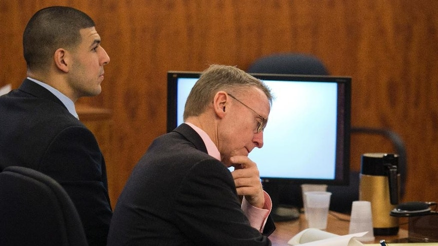 Former NFL player Aaron Hernandez, left, sits with attorney Charles Rankin during Hernandez's murder trial at the Bristol County Superior Court in Fall River, Mass., Feb. 17, 2015. Hernandez is accused in the June 17, 2013, killing of Odin Lloyd, who was dating his fiancée's sister. (AP Photo/Dominick Reuter, Pool)