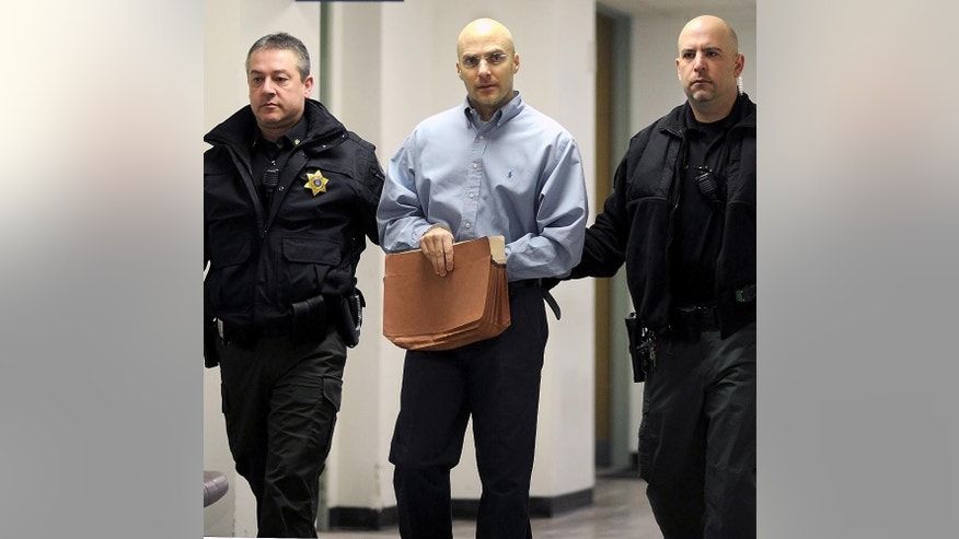 Hugo Selenski is led into the Luzerne County Courthouse, Wilkes-Barre, Pa., Wednesday, Feb. 18, 2015, for the second day of the penalty phase in his double murder trial. A jury on Wednesday spared the life of Selenski, convicted of strangling pharmacist Michael Kerkowski and his girlfriend, Tammy Fassett, during a robbery at the pharmacist's home in 2002 and burying their bodies in his yard, granting a defense request to show mercy despite the brutal nature of the crimes. He will serve life without parole.(AP Photo/The Citizens' Voice, Mark Moran) MANDATORY CREDIT: THE CITIZENS' VOICE, MARK MORAN