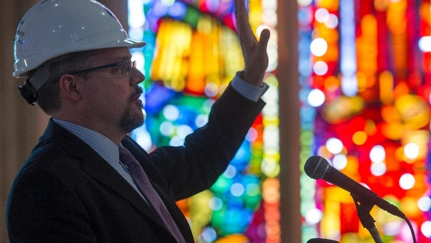 Washington National Cathedral Director of Preservation and Facilities Jim Shepherd talks about repairs and cleaning of the stonework in the ceiling at the Washington National Cathedral in Washington, Wednesday, Feb. 18, 2015. The Washington National Cathedral has finished the first phase of restoration work needed after an earthquake in 2011. The iconic Episcopal cathedral in northwest Washington is holding a news conference Wednesday to discuss details of the restoration work, estimated to cost $32 million overall. Additional restoration work is expected to take years. (AP Photo/Cliff Owen)