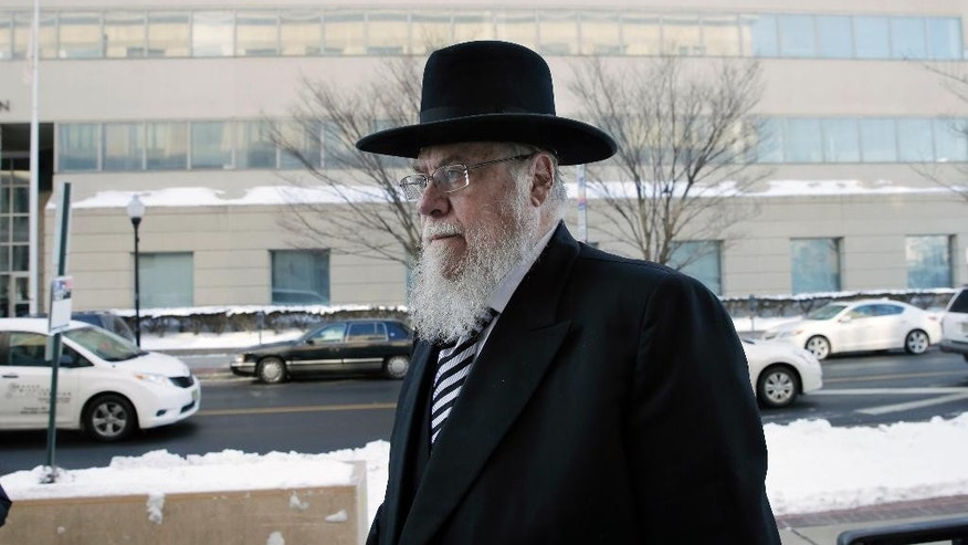 Rabbi Mendel Epstein, right, arrives for his trial at federal court in Trenton, N.J. on Wednesday, Feb. 18, 2015. Prosecutors say Epstein employed a kidnap team to force unwilling Jewish husbands to divorce their wives. (AP Photo/Mel Evans)