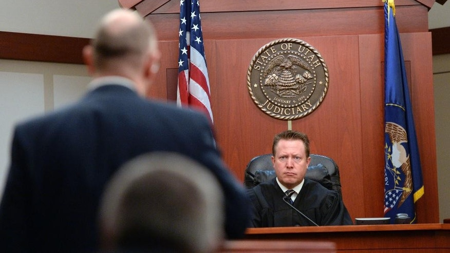 Prosecutor Matthew Janzen, left, speaks to Judge James Blanch at the opening of John Brickman Wall's four-week murder trial in 3rd District Court, Wednesday, Feb. 18, 2015 in Salt Lake City. Wall has maintained his innocence since his arrest in April 2013 despite being accused by prosecutors and his oldest son of killing Von Schwedler. (AP Photo/Salt Lake Tribune, Al Hartmann, Pool)