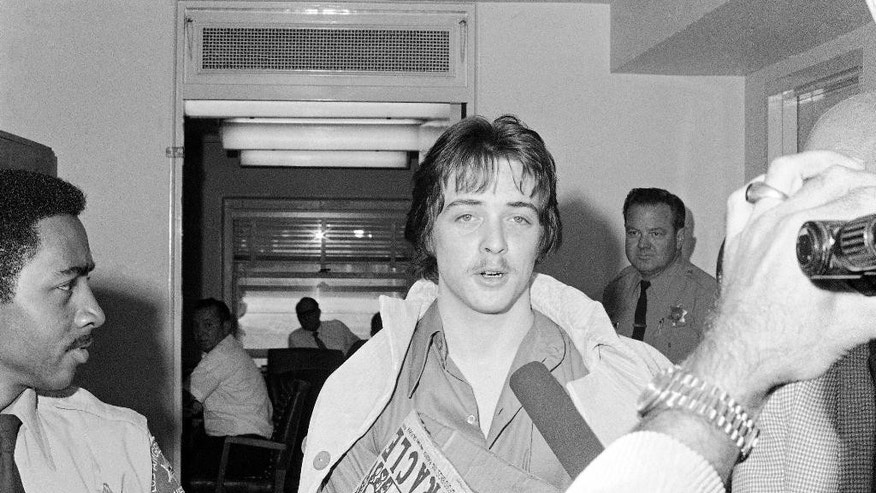 FILE - In this June 15, 1970 file photo, Robert Beausoleil leaves a Los Angeles Superior courtroom after making a plea in Los Angeles.  A parole hearing for Beausoleil scheduled for Thursday, Feb. 19, 2015 has been postponed, according to a spokesman for the California Department of Corrections and Rehabilitation. Beausoleil is serving a life sentence for the 1969 murder of Gary Hinman. (AP Photo/David F. Smith, File)
