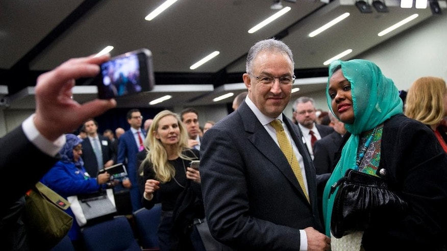 Rotterdam Mayor Ahmed Aboutaleb, left, takes a photo with Deeqo Jibril, of Boston, Founder of the Somali Community and Cultural Association, after they listened to a speech by President Barack Obama speaks at the White House Summit on Countering Violent Extremism, Wednesday, Feb. 18, 2015, in the South Court Auditorium of the Eisenhower Executive Office Building on the White House Complex in Washington. (AP Photo/Jacquelyn Martin)